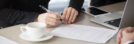 Close up horizontal photo businesswoman hands holds pen sign contract paper official document, affirm new post in company, good deal, credit loan cooperation with bank banner for website header design