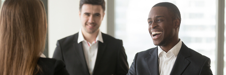 Horizontal photo happy diverse businesspeople acquainted meet at office, ceo handshake with client or african american employee excited by promotion rewarding concept, banner for website header design