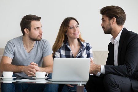 Couple customers renters tenants consulting lawyer or landlord about buying house or apartment rent, agent insurer or financial advisor making real estate presentation offer meeting clients