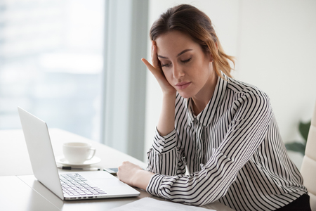 Bored businesswoman tired unmotivated and disinterested in dull work, tired lazy female secretary worker feeling lack of energy, new ideas or motivation, boredom in office and boring job concept Stock Photo