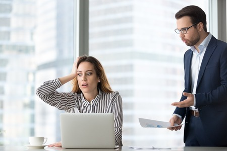 Angry boss scolding terrified stressed lazy female worker for bad work, shocked confused incompetent silly secretary forgot missed deadline worried about mistake in financial report or duties failure
