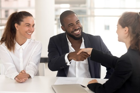 Diverse businesspeople company representatives and client handshaking starting negotiations or hr managers greeting position candidature before interview. Employment and provision of services concept 스톡 콘텐츠 - 118204581
