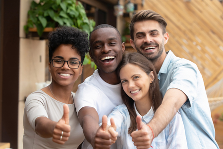 Happy multi ethnic friends group showing thumbs up, smiling diverse young people looking at camera with like gesture recommend good quality racial diversity equality, multiracial friendship, portrait