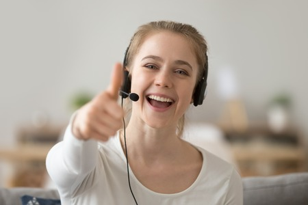 Head shot portrait happy smiling woman, support operator in headset show thumbs up, excited female student like, recommend distance learning languages, educational course, looking at camera Banque d'images - 120573206