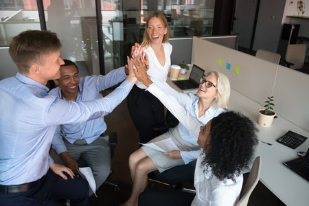 Happy diverse team workers group of business people give high five, mentor coach and employees engaged in teambuilding celebrate unity integrity great result success teamwork together at workplace Banque d'images