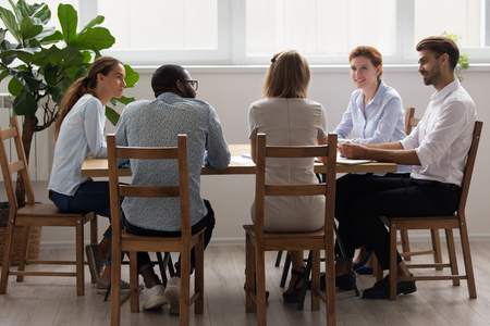 Diverse office business team people talking sitting at table in modern boardroom, multi ethnic employees group discussing work result at corporate staff group meeting working together at negotiation Standard-Bild - 120839352
