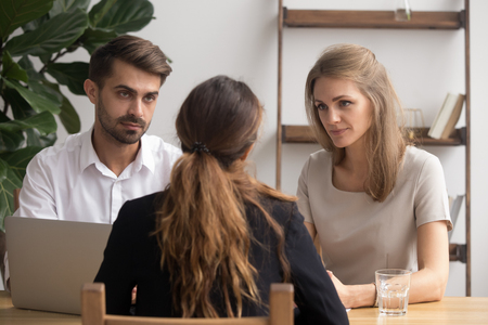 Serious doubtful hr managers listening to female applicant making first impression talking to seeker asking questions at job interview feeling skeptic unconvinced in candidate skill, recruit concept