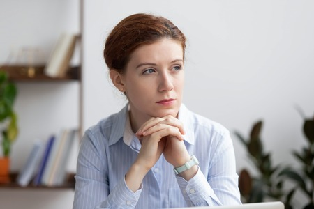 Thoughtful serious pensive businesswoman lost deep in thoughts at work in office looking away thinking of analysis planning business vision considering new opportunities doubting about question. Stock fotó