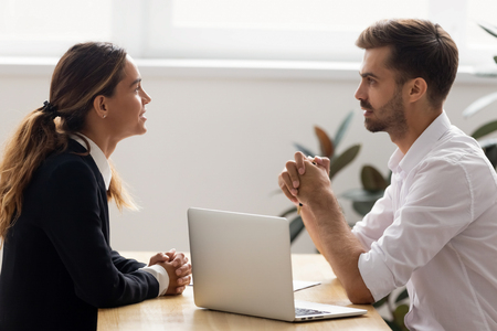 Male hr employer talk to female applicant at job interview ask questions making hiring decision at employment negotiation, company recruiter manager negotiate with client seeker at business meeting