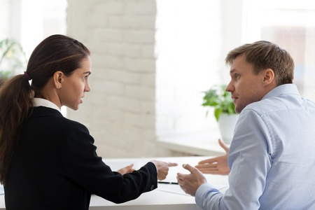 Conflict of female boss and male office worker. Angry bossy business woman shout at irritated man, bad worker. Problem, mistake, stress, depression, overworked, frustrated. People at workplace concept