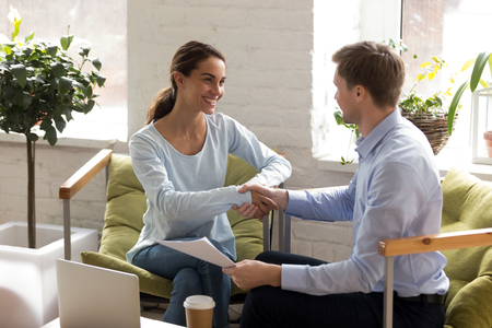 Man and woman shake hands as sign of making deal. Business consulting concept. Meeting with investor, bank worker, financial consultant, insurance or real estate agent. Female excited at job interview Banque d'images - 121256746