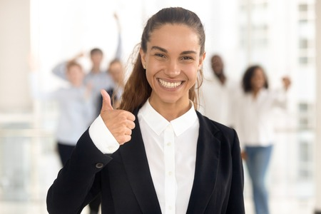 Happy young business woman manager and team people showing thumbs up as good service satisfied client concept, smiling customer hr raise finger looking at camera recommend best choice, portrait
