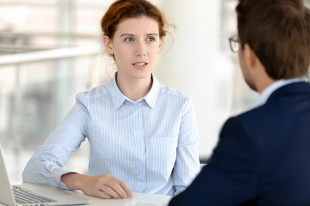 Serious female insurance broker financial advisor consulting male client selling services making business offer, businesswoman bank manager talking to customer explaining loan deal benefit at meeting