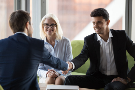 Smiling millennial businessman shake hand of business colleague at casual office meeting, happy partners handshake greeting at briefing, closing successful deal. Partnership, recruitment concept Фото со стока - 124263752