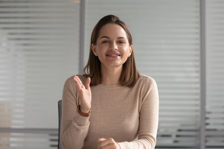 Smiling business woman hr talking with distant client looking at camera skyping calling for online job interview record online training webinar, female teacher coach shoot video training, webcam view Stock Photo