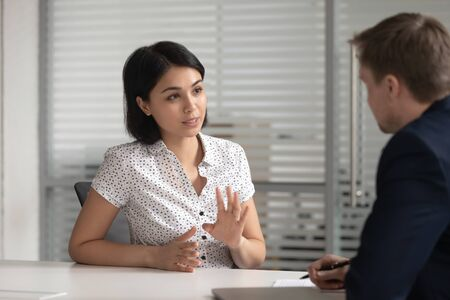 Female asian bank manager insurer job applicant talk to male hr consult customer at interview meeting, japanese broker explain deal benefits to client make offer, recruit and business advice concept