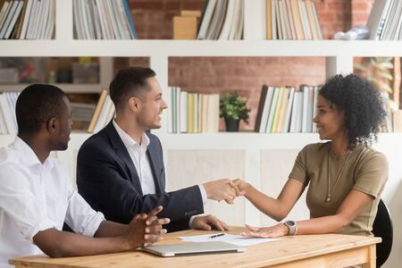 Diverse people gather for negotiations in office african businesswoman handshaking with caucasian businessman at business meeting client and company executive manager or starting job interview concept
