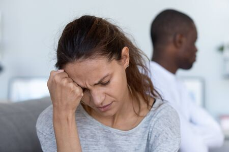 Depressed upset young woman wife feeling frustrated offended and sad after fight with stubborn selfish jealous husband suffer from bad relationships, unhappy marriage and family problems concept