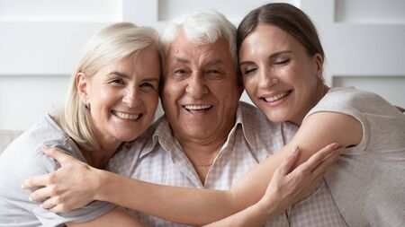 Horizontal banner close up image of three-generation family portrait happy beautiful faces, adult daughter embracing 80s father 60s middle-aged mother closest relatives people, good relations concept 写真素材 - 131664926