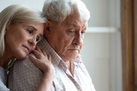 Senior spouses remember sad moments of life together, middle-aged adult daughter snuggle up to elderly father sharing his sorrows and heartache, embrace as symbol of empathy and compassion concept 写真素材 - 131665059
