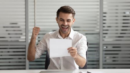 Happy businessman reading document, business letter, laughing employee excited by good news, celebrating success, get job or promotion, holding paper, student receiving positive exam results