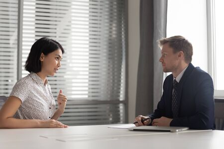 Recruiter listening to young Asian candidate at job interview, confident applicant answering to recruiter questions, introduction, good first impression, recruitment process, human resources Stock Photo