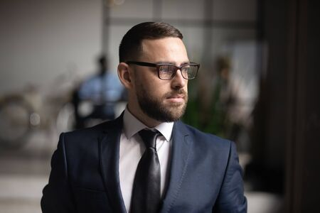 Serious thoughtful doubtful businessman executive leader wear suit looking away think of future challenges ideas new opportunities investment risks dream of success new goals, business vision concept
