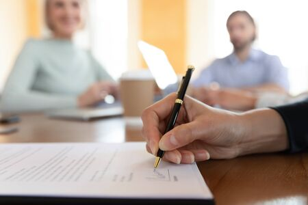 Businessman customer bank loan service buyer sign paper document at meeting, male client buy insurance get hired make business deal write signature on employment contract agreement, close up view Stok Fotoğraf