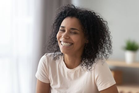 Portrait happy African American woman with wide healthy smile close up, funny female having fun at home, excited by success, good news, satisfied client customer, great offer, whitening service