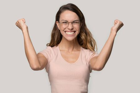 Happy excited young woman wearing glasses celebrating success Stockfoto