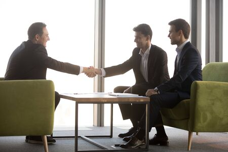 Smiling Arabian hr manager shaking hand of candidate, greeting on job interview, diverse business partners handshaking at meeting after contract signing, making deal, collaboration concept