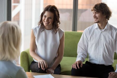 Smiling hr managers holding job interview with mature candidate in office, first impression, business partners discussing contract terms, successful negotiation, friendly employees consulting client