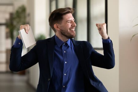 Applicant celebrating successful job interview ending got company position hired feel very happy. Businessman raises hands clenched fists after making profitable deal, promoted, reward getting concept
