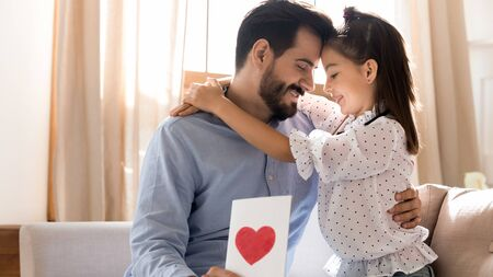 Cute little girl hug cuddle happy young Caucasian father present handmade postcard with red heart painted, caring small daughter embrace make birthday surprise to excited dad show love and affection Stock fotó - 138373236