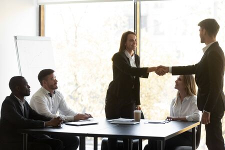 Negotiations starts with parties shaking hands. Friendly boss greets corporate client express respect handshaking begin meeting, good first impression, congratulation with successful work done concept