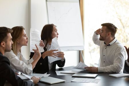 Businesspeople argue with client dissatisfied with contract terms, mad group of people have dispute with business partner discontented with agreement, claim money back, mistake caused financial loss