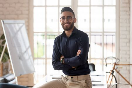 Successful arab businessman arms crossed look at camera smiling pose inside of modern boardroom, career growth, succeed goal, accomplish profitable project, human resources specialists recruit concept Stock fotó