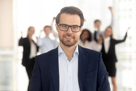 Close up head shot portrait smiling millennial businessman in office. Happy male employee with eyewear ceo guy looking at camera, headshot confident successful man boss or manager at work.