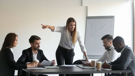 Angry female team leader director manager asking upset frustrated african american employee to leave business group meeting because of project failure, professional incompetence, bad work results.