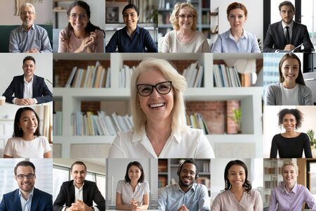 Webcam pc screen view during group video call, many faces diverse colleagues participating in on-line meeting led by mature 50s businesslady, e-coaching, video conferencing, worldwide app easy usage Foto de archivo