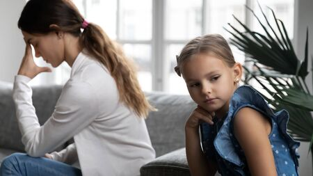 Stubborn young Caucasian mother and little preschooler daughter ignore avoid talking after family fight, hurt offended mom and girl child feel mad upset, misunderstanding, generation gap concept
