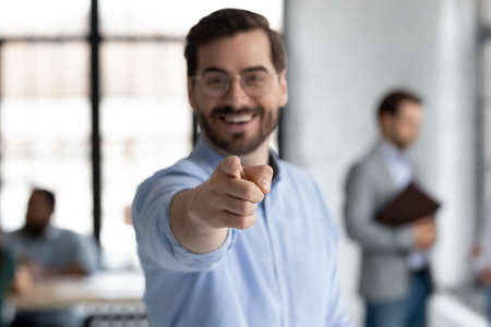 Close up focus male point finger at camera, employer company boss gives you chance career opportunity, HR manager makes choice, choose lucky applicant. Human resources, employment, recruiting concept