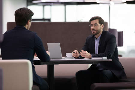 Job interview meeting, hr manager interviewing male candidate asking questions and listen to candidate answers. Human resources manager with employee communicating. Hr recruitment concept Stockfoto