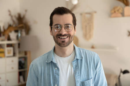 Profile picture of smiling young Caucasian man in glasses show optimism positive and motivation, headshot portrait of happy millennial male client customer in spectacles satisfied with good service
