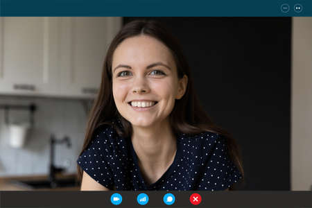 Close up headshot screen view portrait of smiling millennial woman talk speak on video call. Happy woman have in webcam virtual digital conference or conversation. Online communication concept. Stock fotó