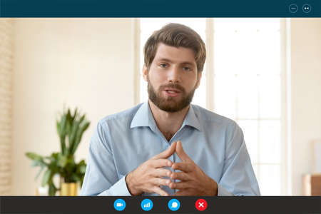 Head shot portrait screen view with app interface confident businessman speaking and looking at camera, coach mentor recording webinar, manager engaged in internet negotiations, video call concept