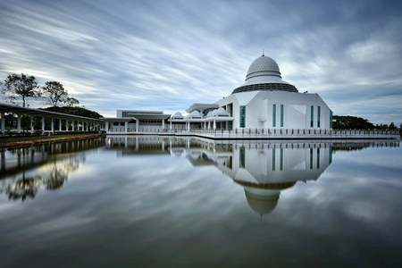 Majestic view of An Nur Mosque with stunning reflections during sunrise