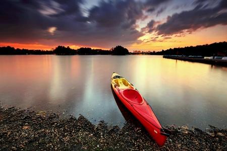 Canoe at lake during long exposure sunset in Putrajaya Malaysia