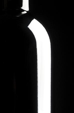 Silhouette of wine bottle, black background