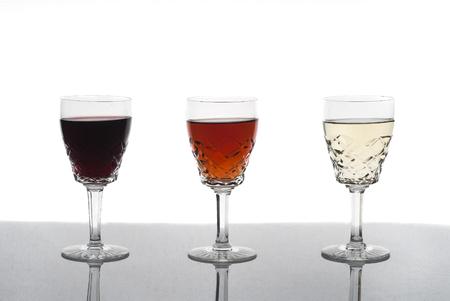 Three glasses of wine, rose wine, red wine, white wine, white background